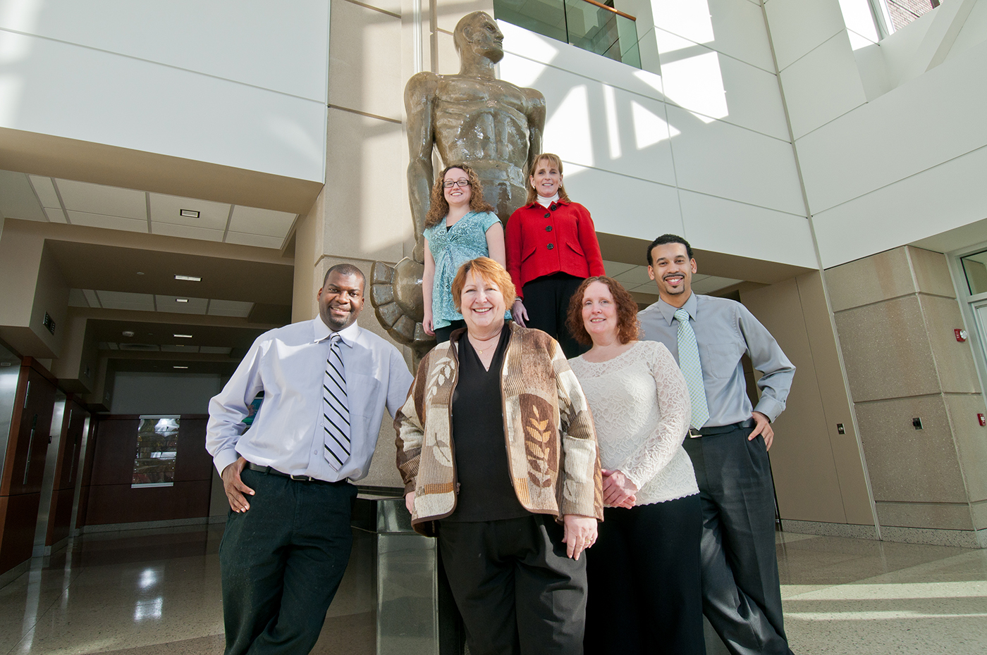 MSU staff standing in front of Sparty Statue