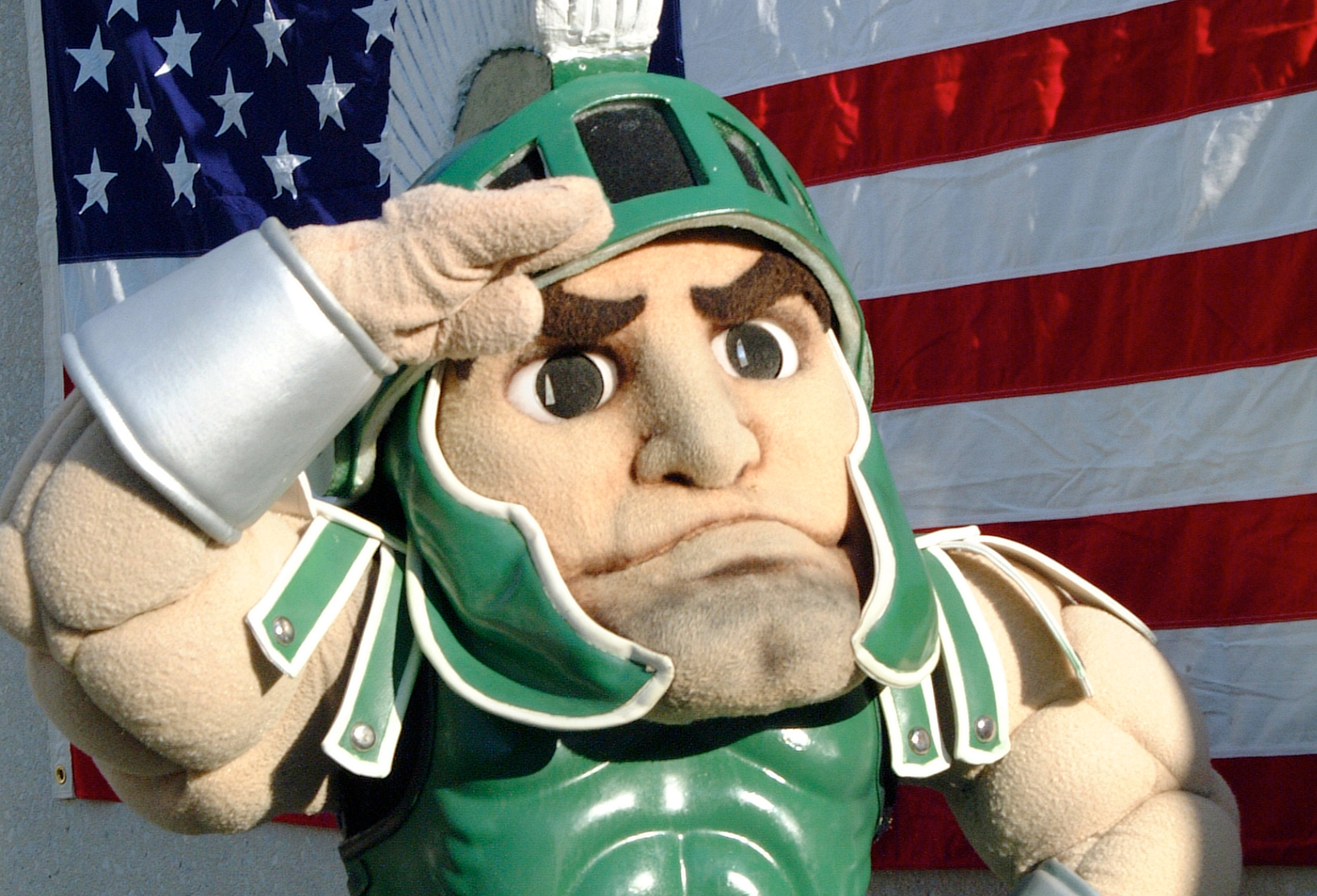 sparty in front of flag
